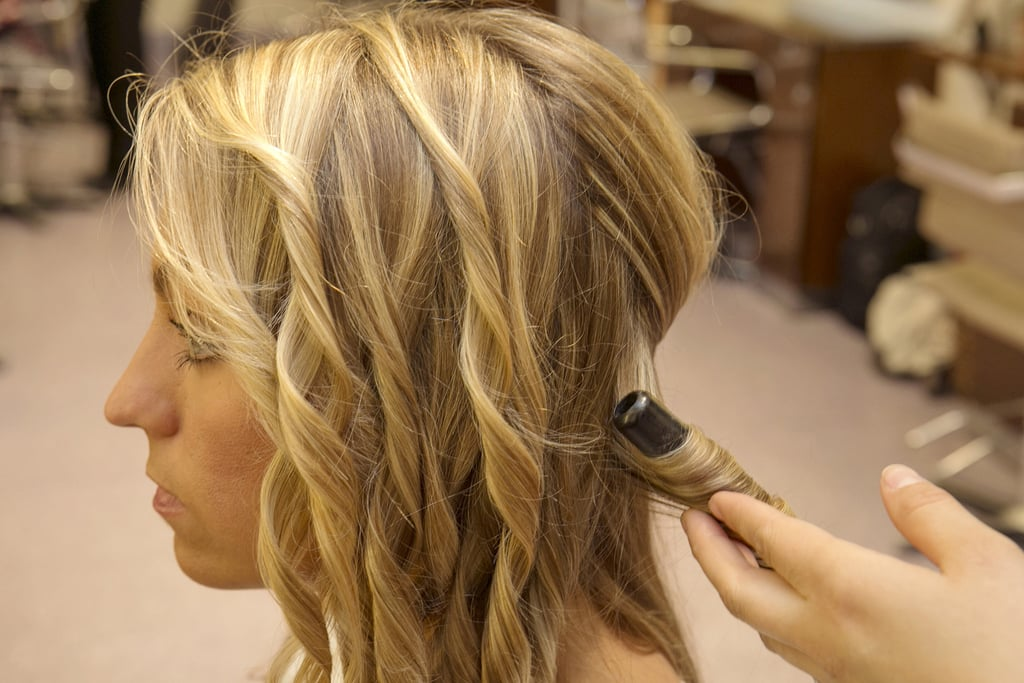 Next, use a curling iron to create beach waves or to enhance your hair's natural texture. Guillen recommends using a smaller barrel for thinner hair, while thicker hair can use larger barrels.