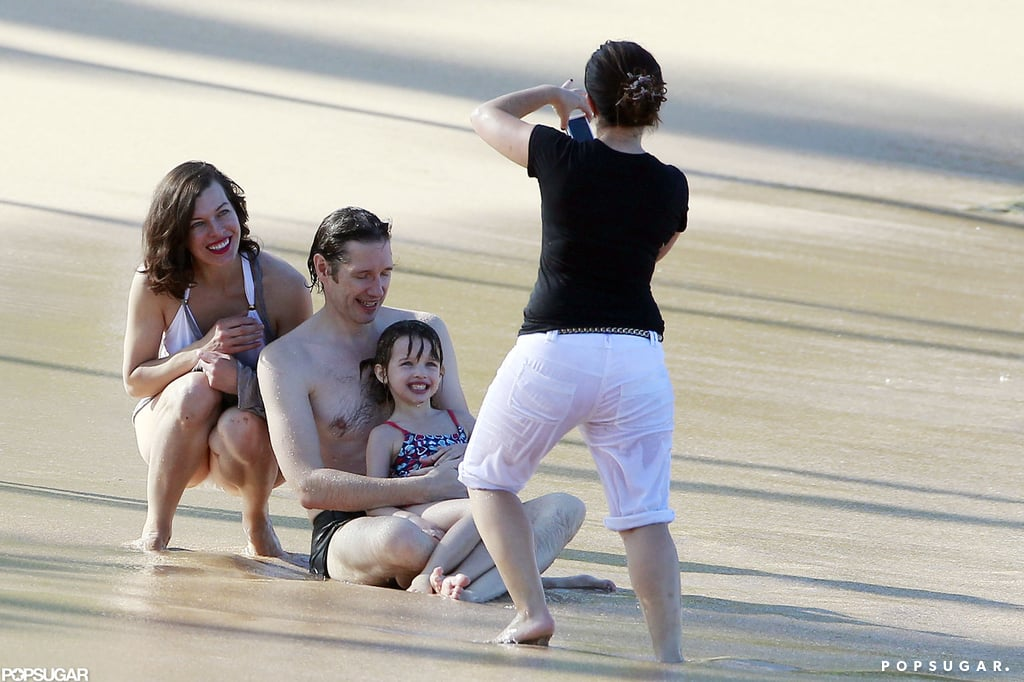 Milla Jovovich and her family posed for a beach photo.