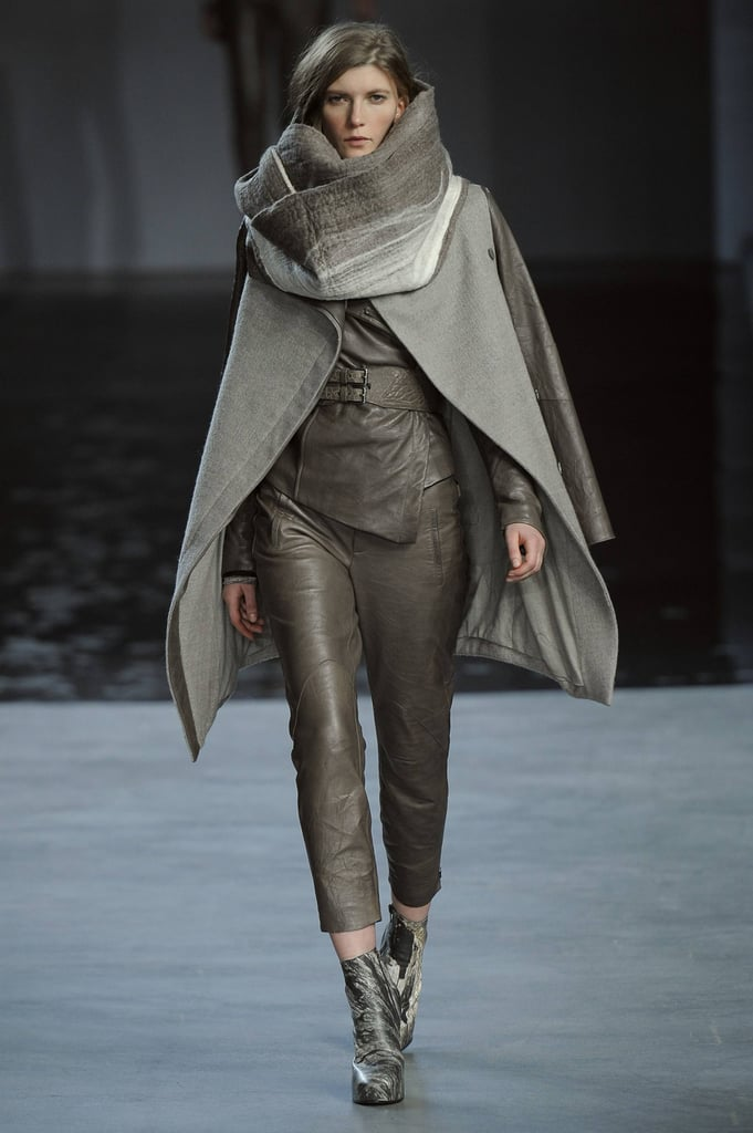 The whole outerwear styling here is key: a louche wool coat layered with the biggest scarf/blanket for a downtown wintry cool vibe.