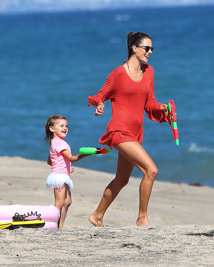 New mum Alessandra Ambrosio frolicked on the beach in Malibu with her daughter on July 6.