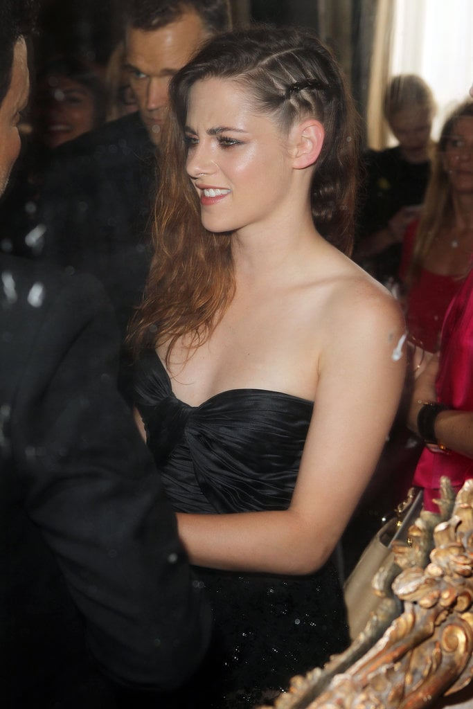 Kristen kept it simple with messy texture and a deep side part.