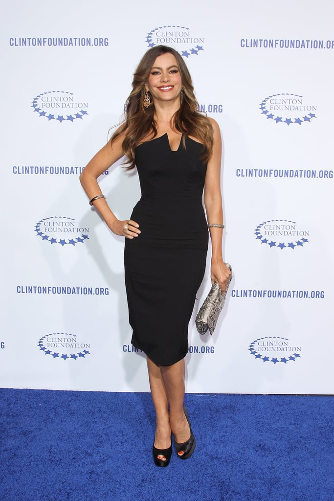 """Sofia nailed the balance of sophisticated and sexy in a sharply structured black sheath and satin pumps for the Clinton Foundation's """"A Decade of Difference"""" Gala in October 2011."""