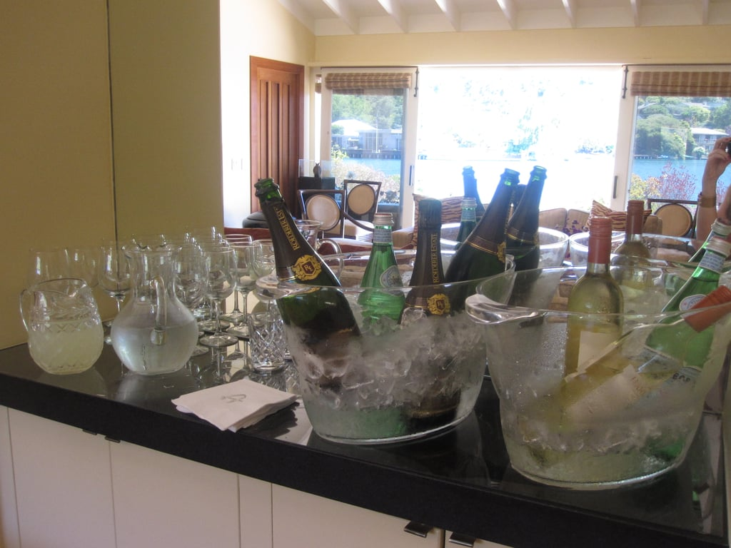 White wine and sparkling wine were placed on a nearby bar with glasses and lemonade.
