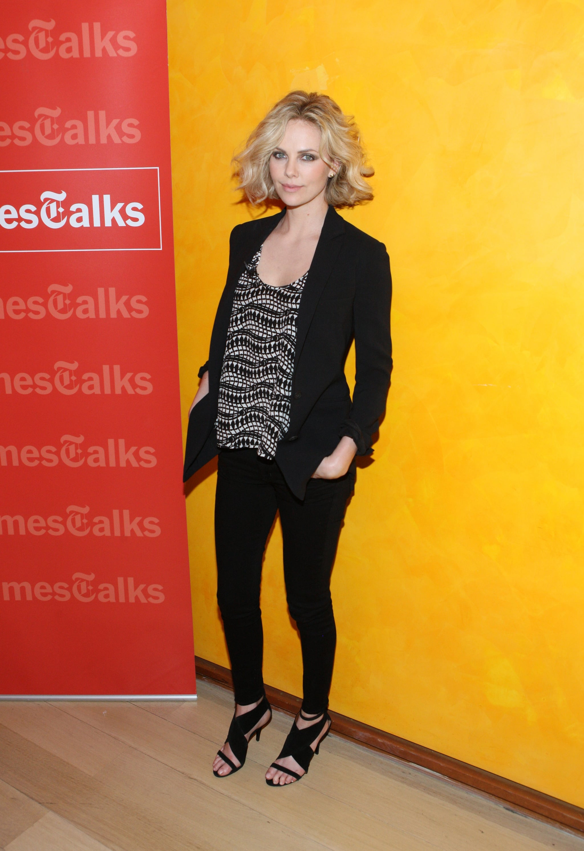 For a New York Times talk, Charlize wore a printed Thakoon top, Stella McCartney black blazer, and J Brand jeans.
