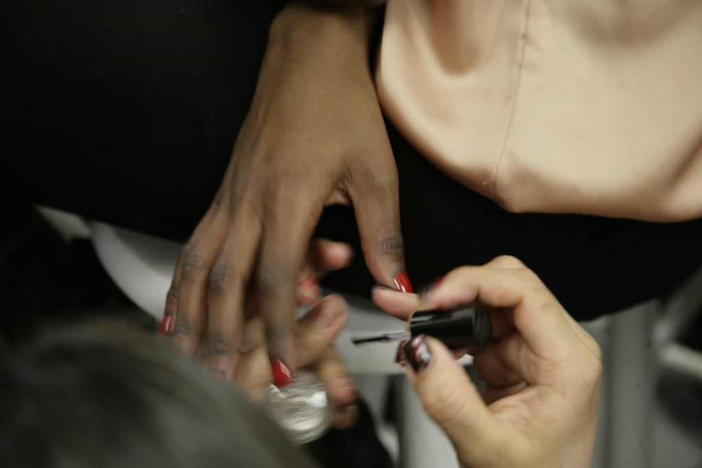 Nails were painted with MAC's Flaming Rose (available in Fall), a perfect true red, that matched models' lips perfectly. Photo: Megan Holmes