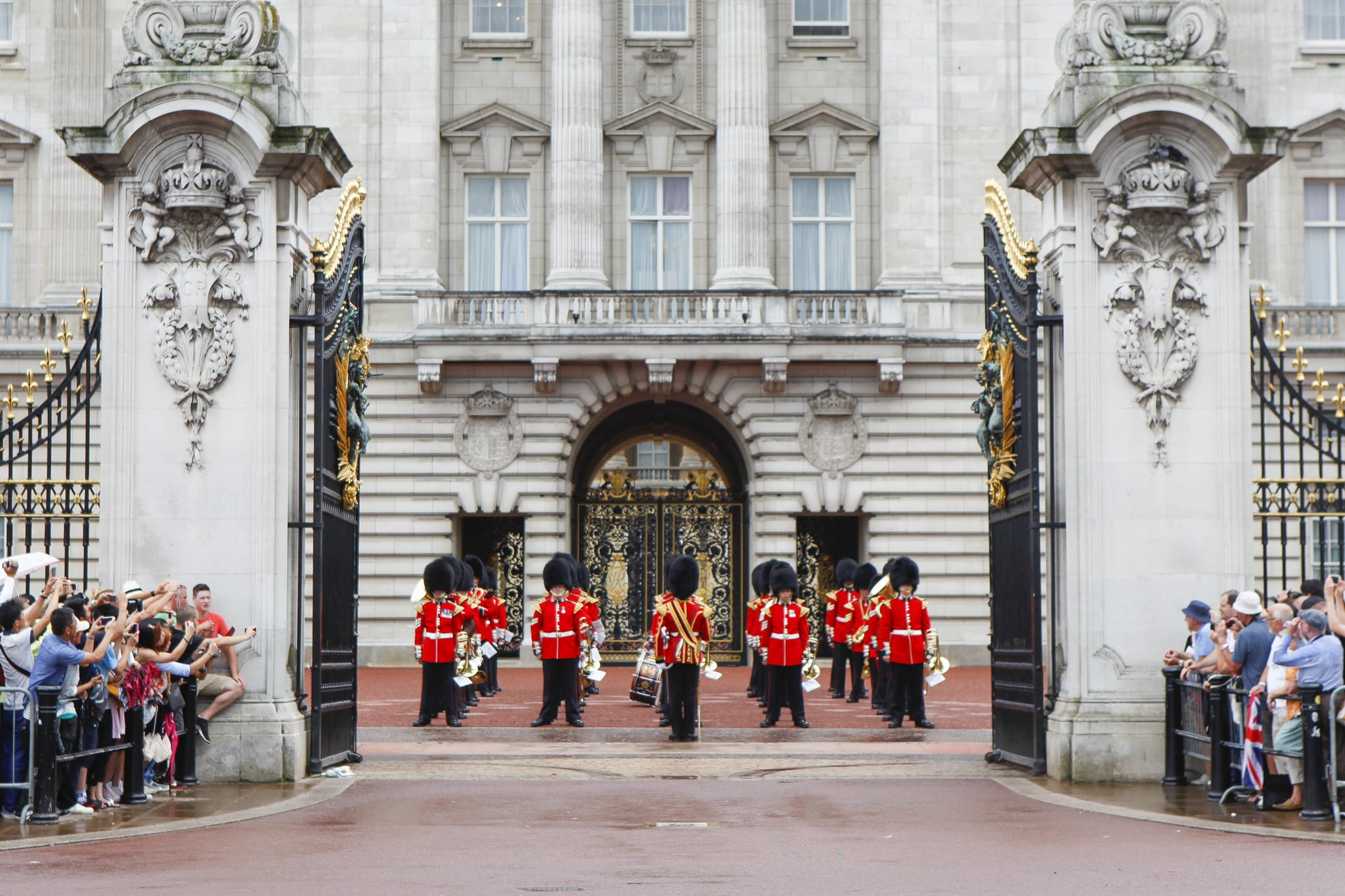 People flocked to Buckingham Palace the day after the baby was born for a chance to see the official bulletin on the easel along with the Changing of the Guard.