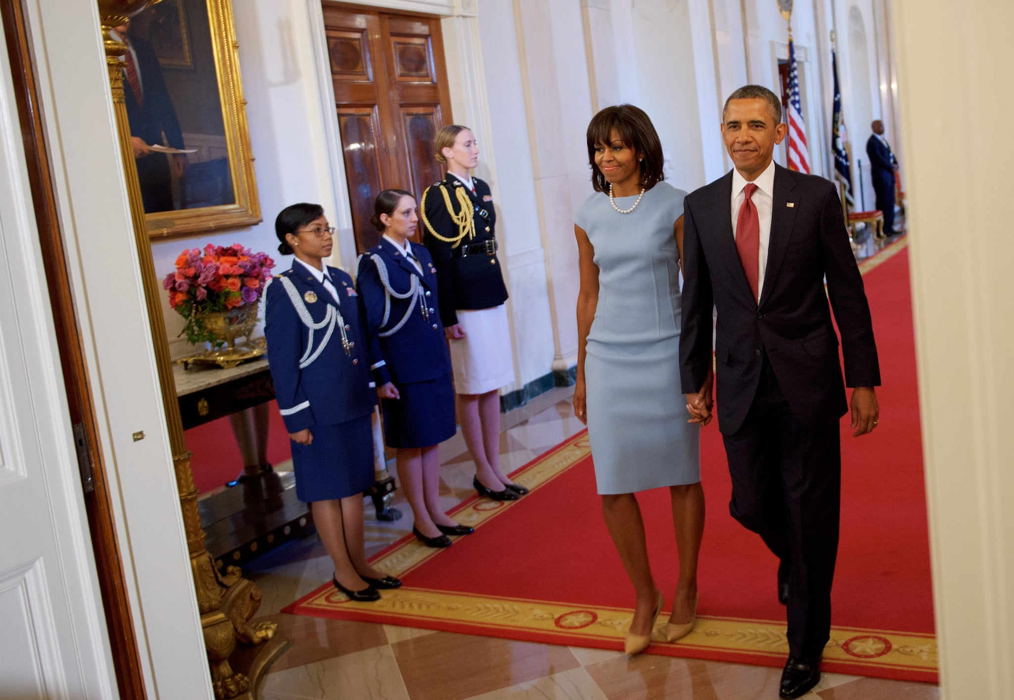 Michelle Obama wore a pastel blue Michael Kors sheath, along with pearls and nude pumps, to a medal of honor presentation in April.