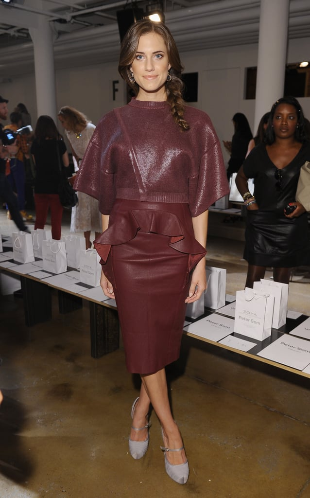 Allison showcased a monochromatic ensemble — a cropped metallic sweater and peplum leather pencil skirt — with satin ankle-strap pumps at Peter Som during Spring 2013 NYFW.