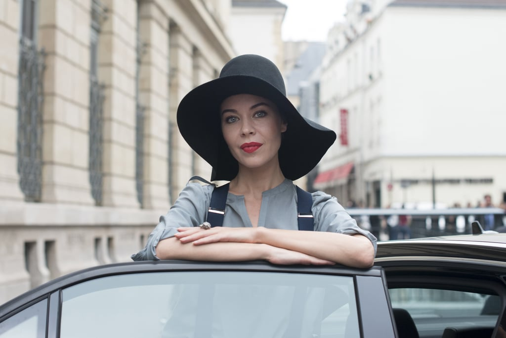 When in doubt, a slicked-back style looks insanely chic under an oversize chapeau.