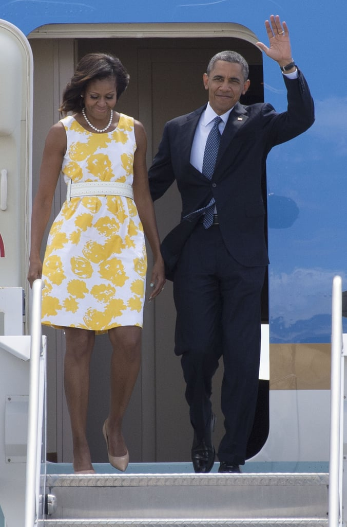 Michelle proved she is the queen of shopping when she stepped off Air Force One in a yellow and white dress by Talbots (a steal at only $56!) which she accessorized with a white belt.