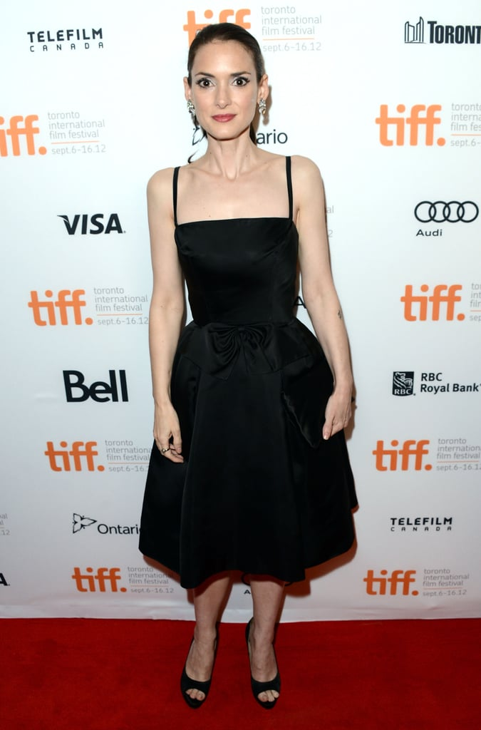 Winona Ryder stuck to her minimalist palette of classic black dresses. Her drop earrings and peep-toe pumps completed her Iceman premiere outfit.