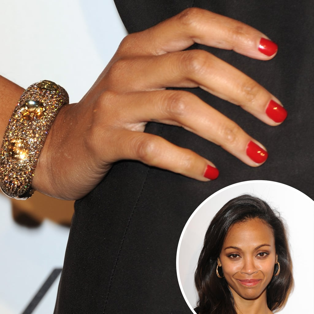 She loves a red-hot manicure, so Zoe Saldana displayed a shiny shade at the Weinstein Company party.