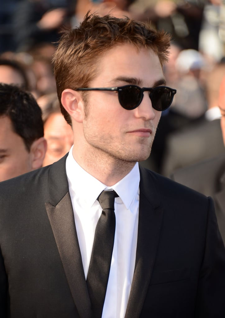 Robert Pattinson rocked some shades on the red carpet for girlfriend Kristen Stewart's On the Road premiere at the Cannes Film Festival.
