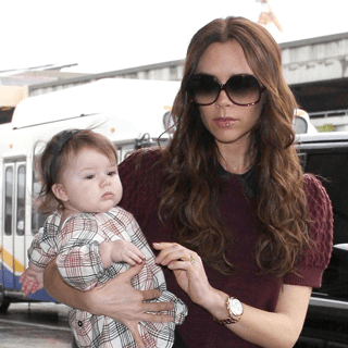 Victoria Beckham in Miu Miu and Walter Stieger at LAX