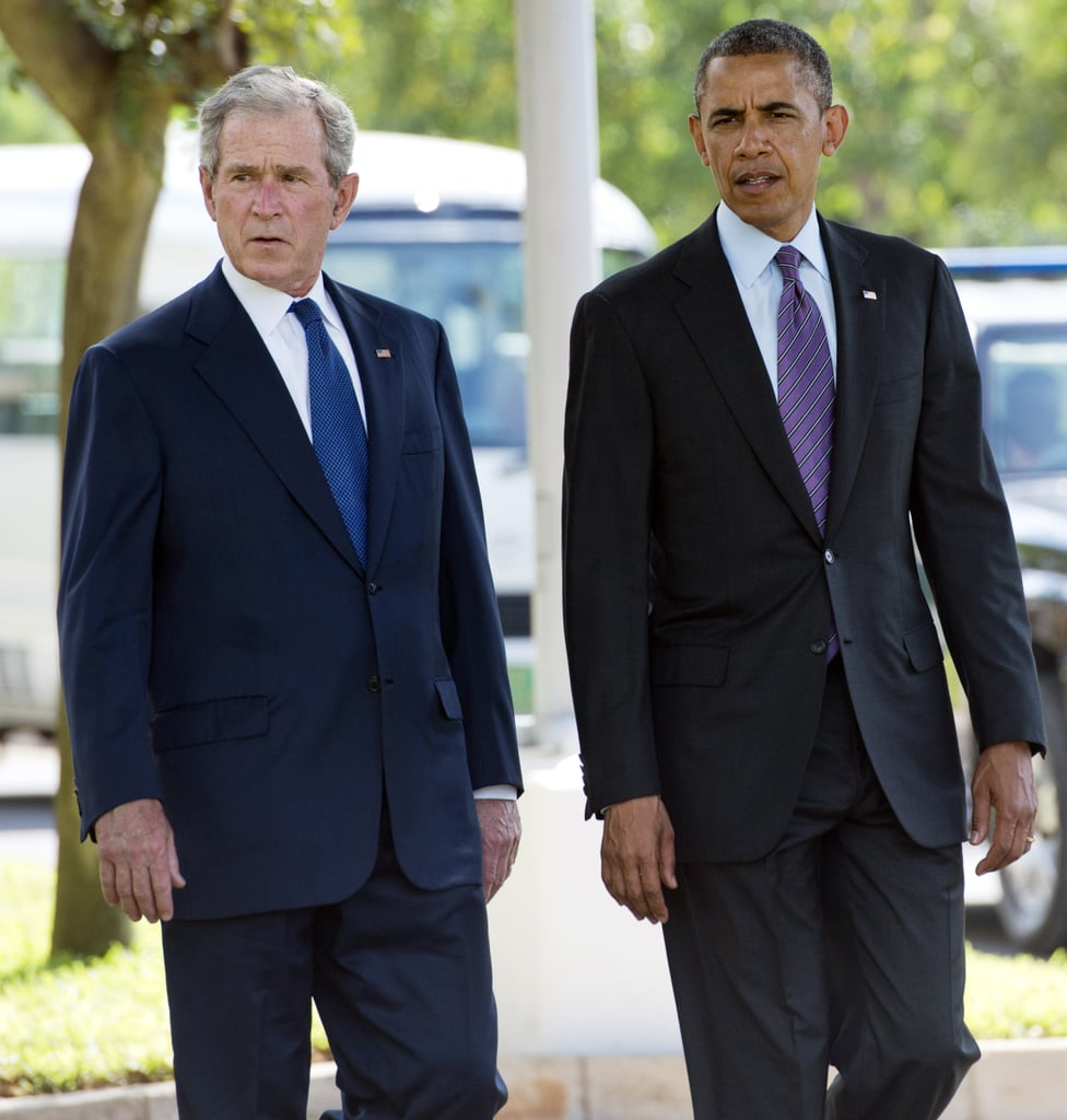 President Obama and former President George W. Bush walked together while they were both in Tanzania in July 2013.