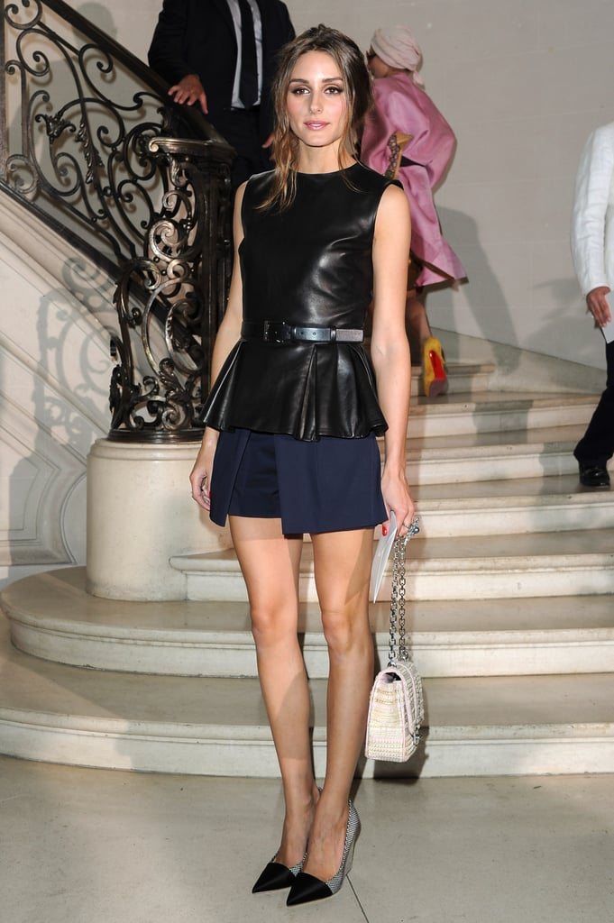 Olivia Palermo outfitted her brand of eclectic polish in a peplum-trimmed leather shell, smart navy shorts, and pointed-toe wedges.