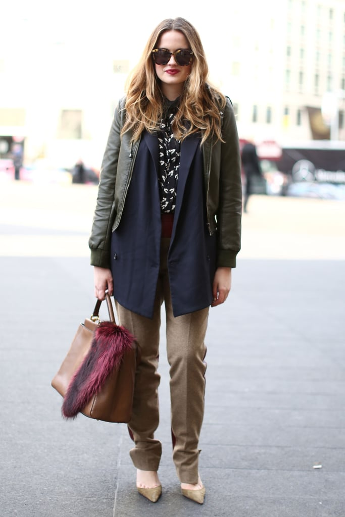 Here's a cool trick: layer your menswear-inspired blazers with a cool leather jacket for a modern play on proportion.