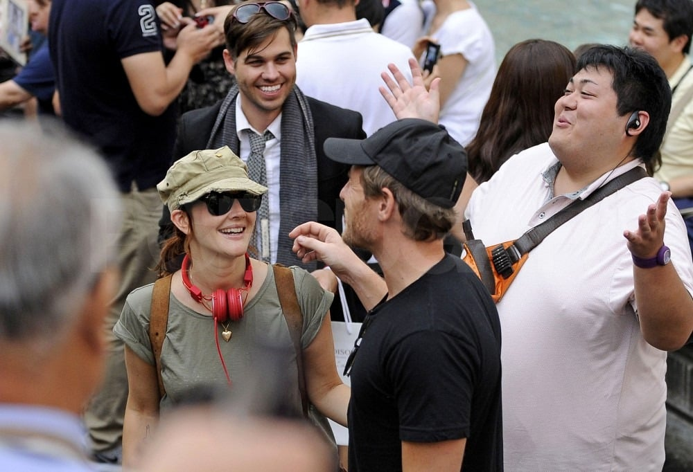 Drew and Will laughed with the crowd of tourists and Italians.