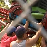 County Fair Bystanders Hold Up a Kids' Roller Coaster After It Collapses Midride