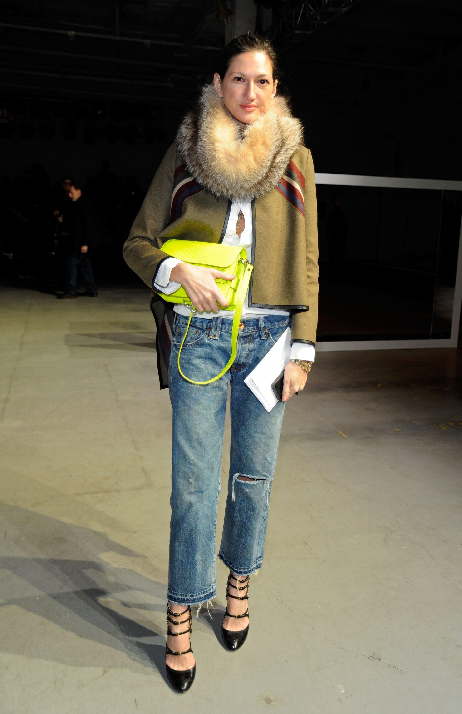 Fancy accessories dress up her trusty oversized jeans.