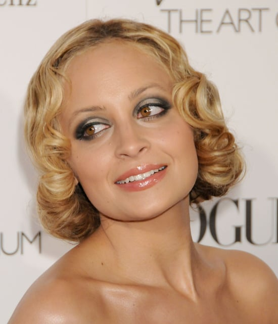 With her silver eyes, peach lips, and soft finger waves, Nicole was the vision of Old Hollywood.
