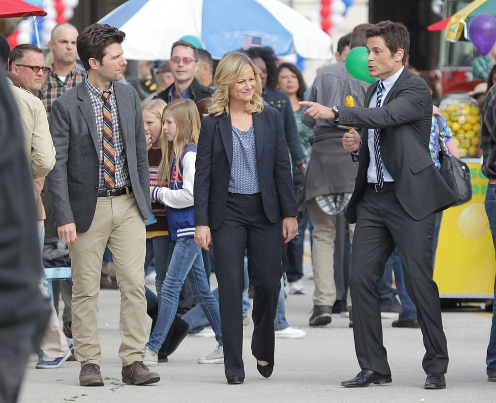 Amy Poehler teamed up with Adam Scott and Rob Lowe for a scene at a carnival.