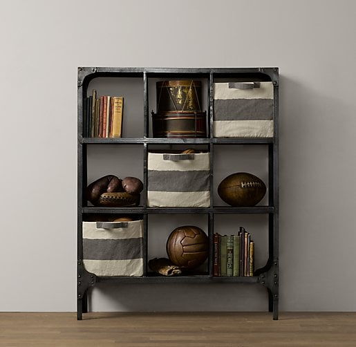 This cubby shelving ($599) from Restoration Hardware has enough space to store your tot's books along with lots of other clutter from your child's floor. And with large open areas that allow your tot to see just where everything is, this industrial-style shelf really makes a statement in any room.