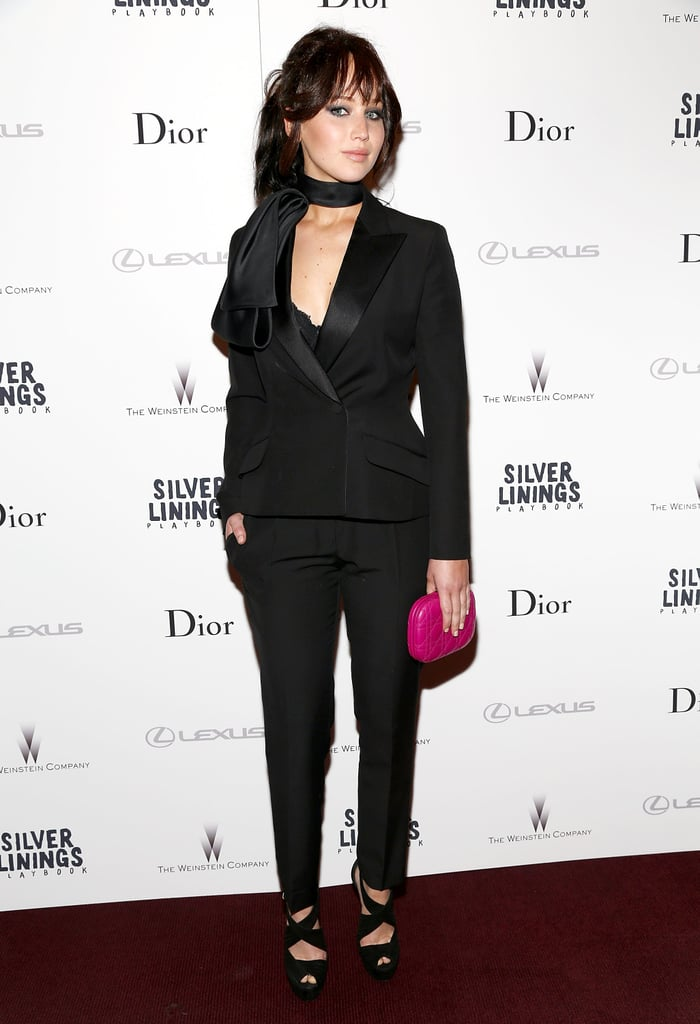 Jennifer Lawrence switched gears in a Christian Dior black tuxedo suit and finished with strappy sandals and a fuchsia Dior clutch at the Silver Linings Playbook premiere in NYC.