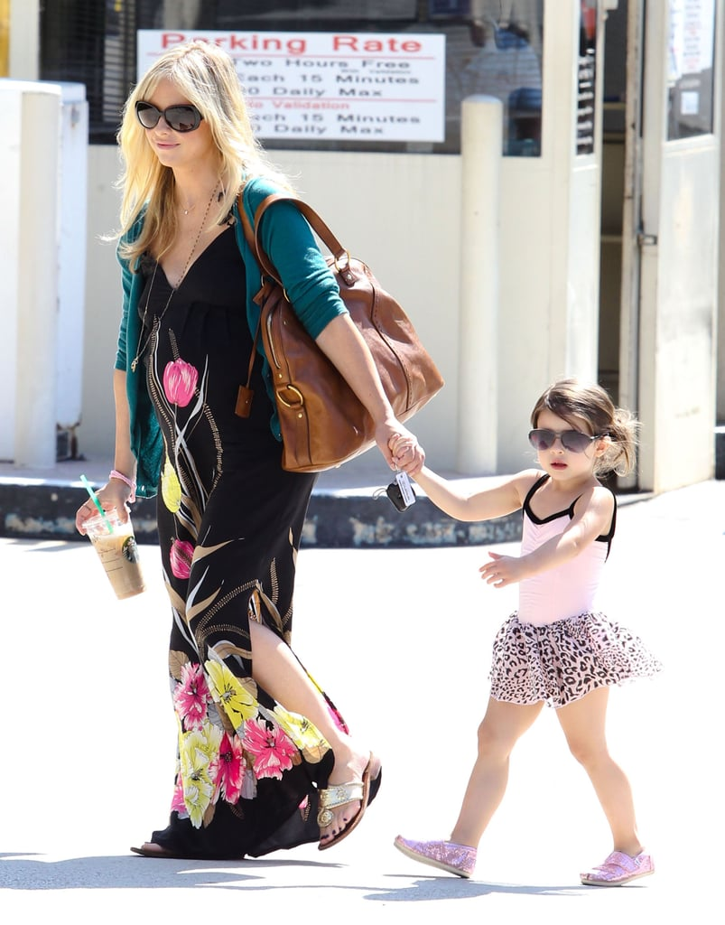 Sarah Michelle Gellar and Charlotte Prinze walked hand in hand.