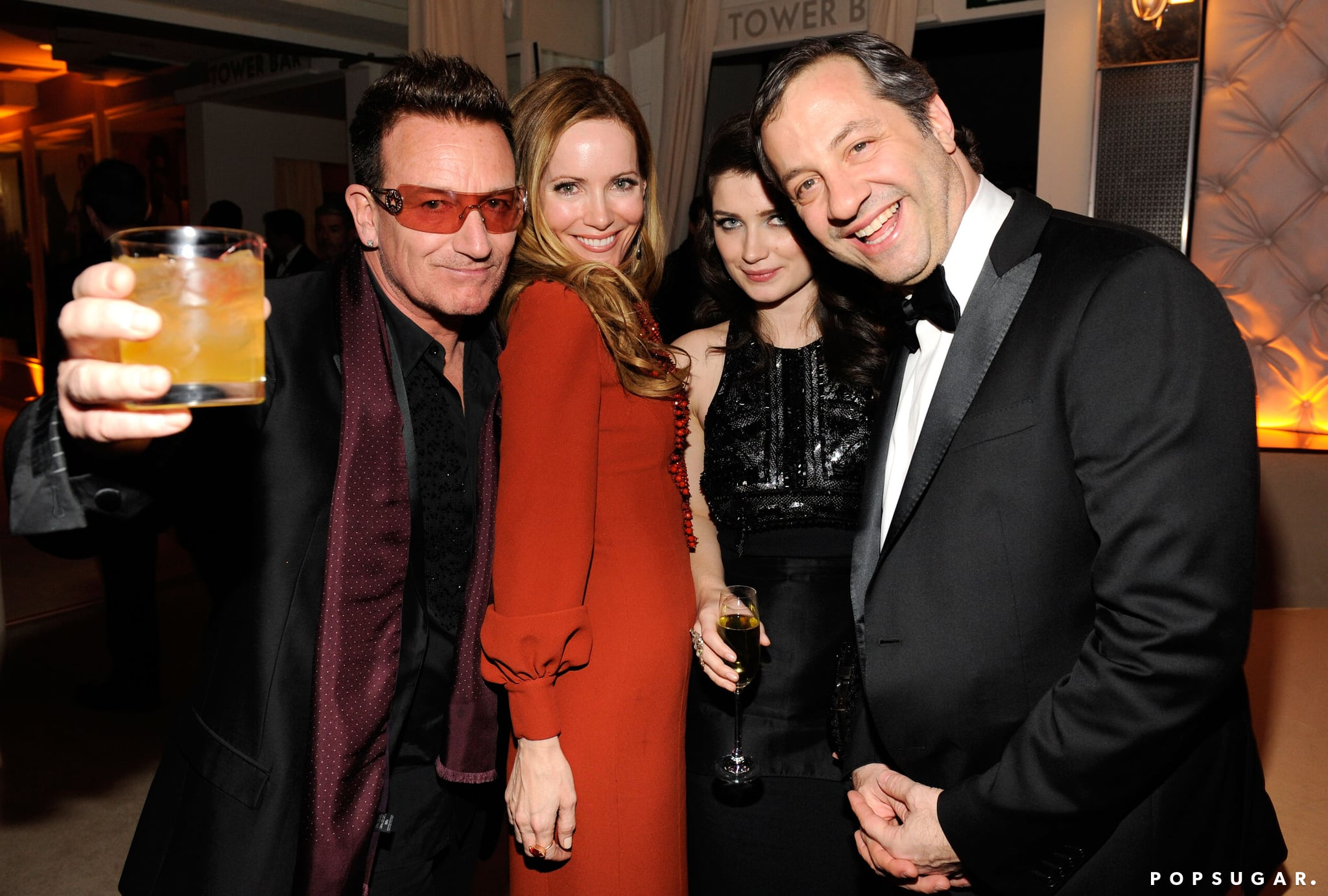Bono raised his drink and posed with Leslie Mann, Eve Hewson, and Judd Apatow at the Vanity Fair party.