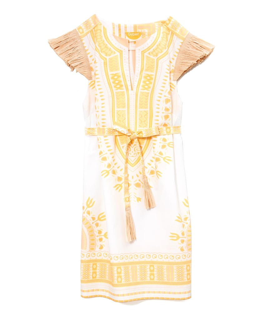 """Nothing says """"summertime"""" like this amazing Gypset Coco Dashiki dress ($350). The yellow print would look amazing against sun-kissed skin, and how cool is the raffia sleeve detailing? — Chi Diem Chau"""