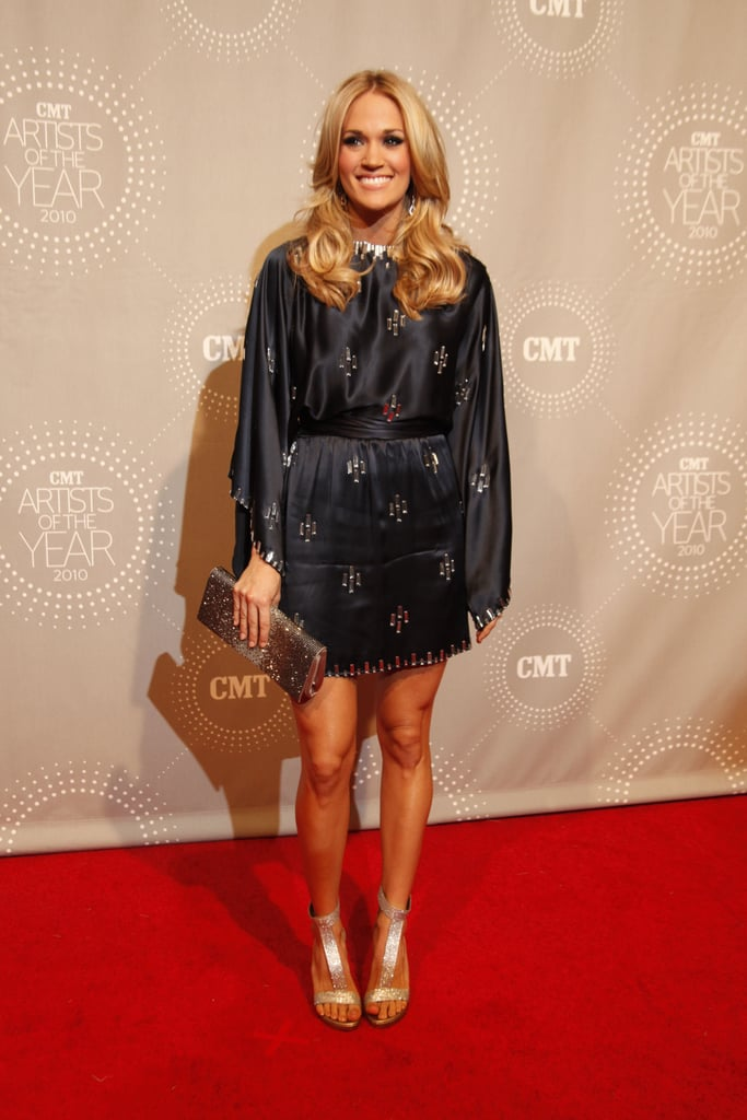 A crystallized navy blue Jenny Packham kimono wrap dress, with shimmering Stuart Weitzman T-strap sandals, at the 2010 CMT Artist of the Year Awards.