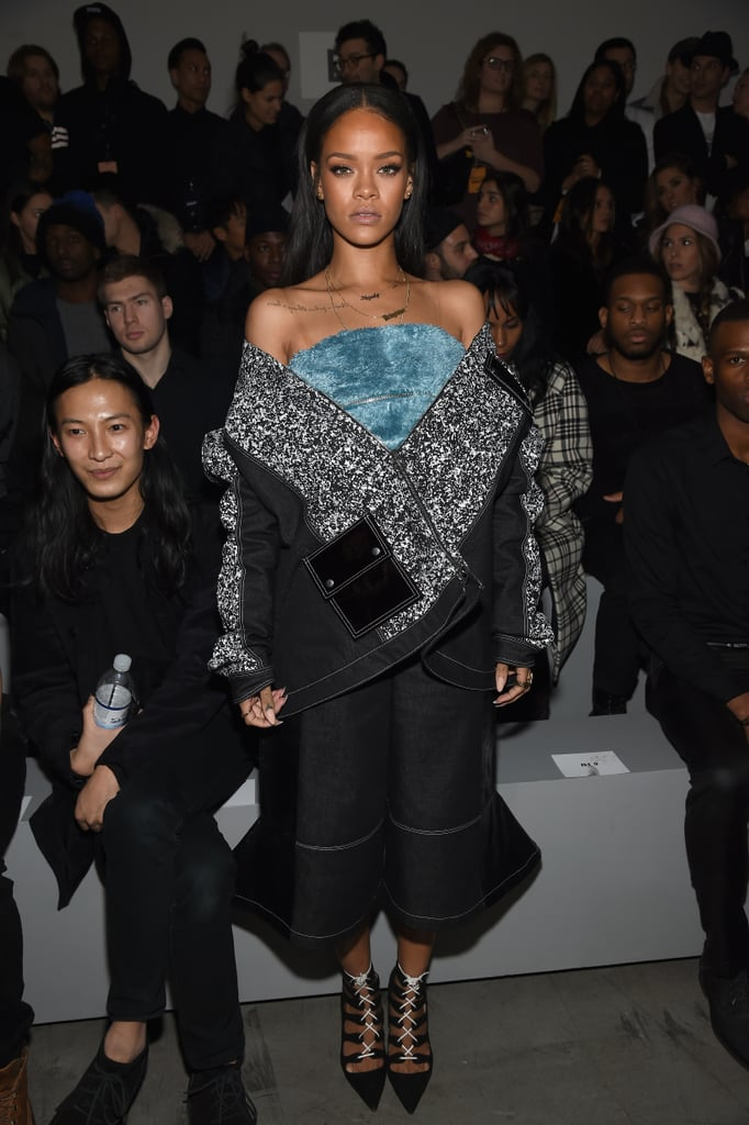 Rihanna posed next to Alexander Wang while she waited for the Adidas Originals x Kanye West Yeezy show to start in Feb. 2015.