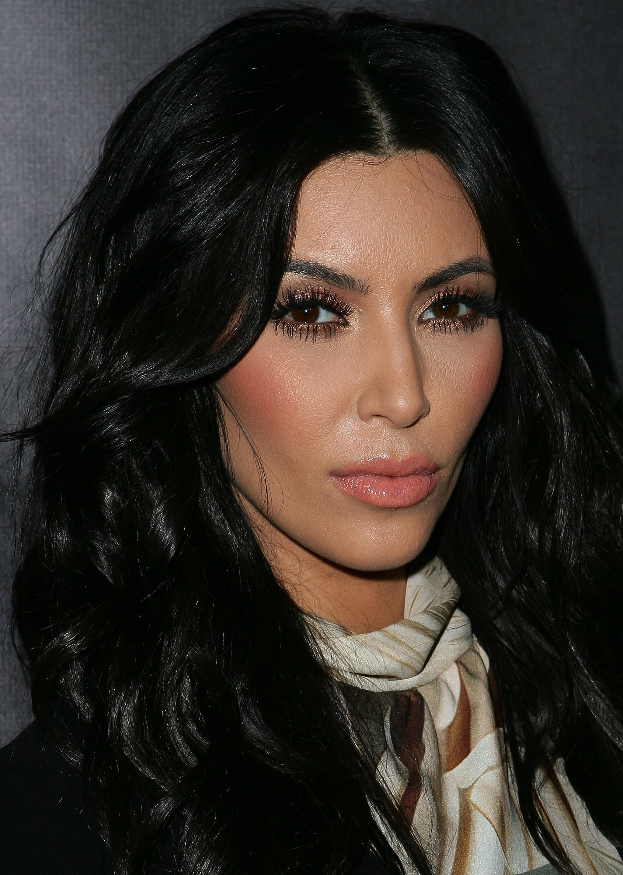 Kim Kardashian held a serious expression at the launch of the Kardashian Kollection on Sydney.
