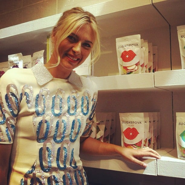 Maria Sharapova posed with packages of her candy line, Sugarpova. Source: Instagram user instylemagazine