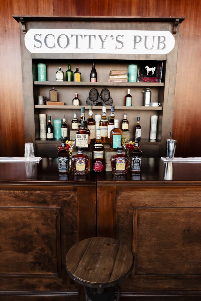 The groom's side was well represented with a scotch bar and lounge area — called Scotty's Pub after Stuart's family — filled with true scotch whiskeys that were actually brought in by his family, some that you couldn't even get here in the States.  Photo by Chrisman Studios