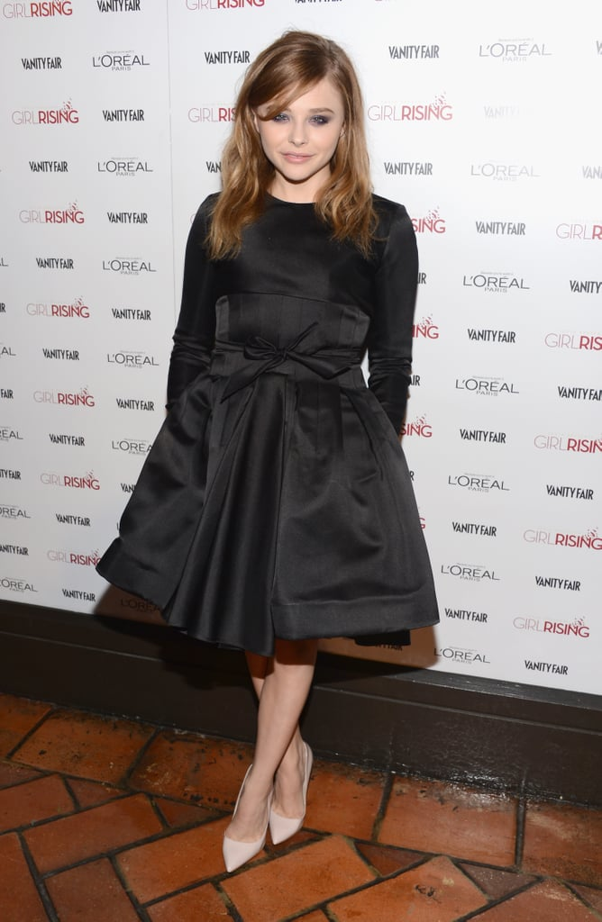 At a Vanity Fair soiree in LA, Chloë Moretz tried the fit-and-flare silhouette in a full-skirted black satin Christian Dior dress from the Pre-Fall 2013 collection, which she completed with nude Rupert Sanderson pumps.