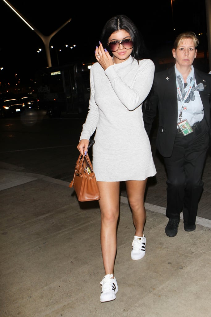 Skip struggling in heels and rock kicks with your dress, just like Kylie Jenner did. If need be, you can always change when you land!