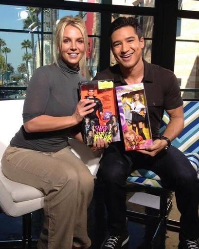 Britney Spears and Mario Lopez traded dolls during an Extra interview. Source: Twitter user MarioLopezExtra