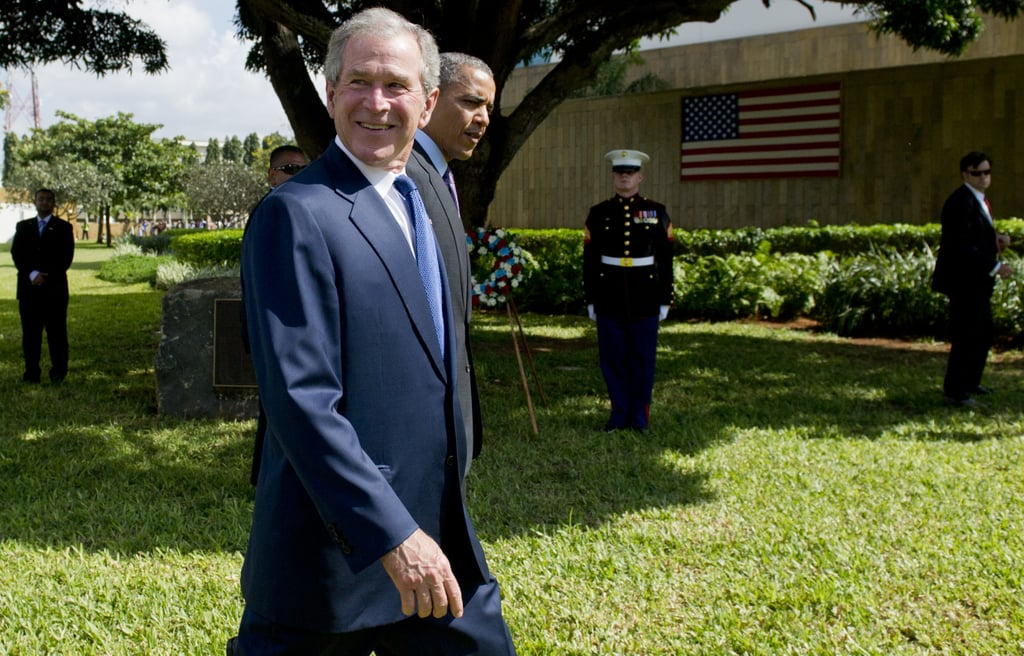 In July 2013, former President George W. Bush smiled next to President Obama as they arrived at the wreath-laying ceremony for victims of the 1998 US Embassy bombing in Tanzania.