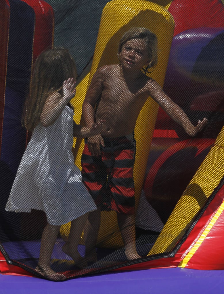 Kingston Rossdale played with another little friend at Joel Silver's Memorial Day party in LA.