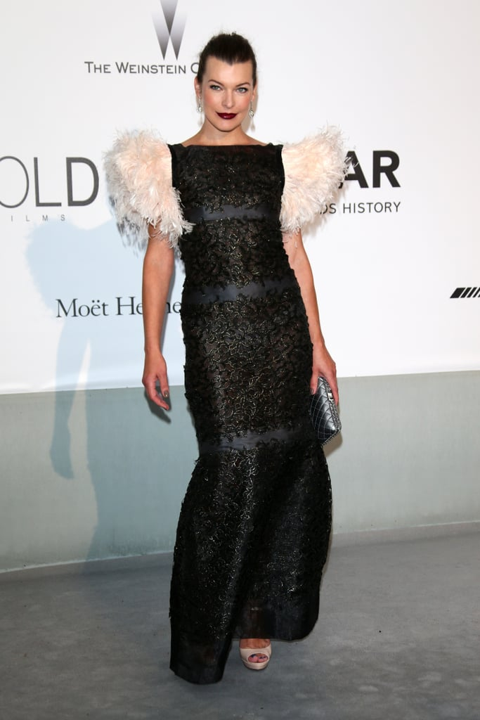 Milla Jovovich sported a feathered gown.