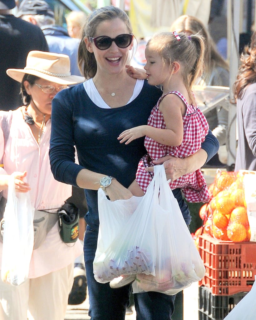 Seraphina helped Jen pick out fresh fruit and veggies.