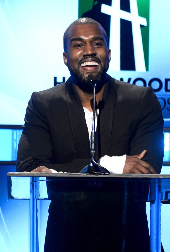 Kanye West presented at the Hollywood Film Awards before flying to San Francisco and proposing to Kim Kardashian on Monday night.