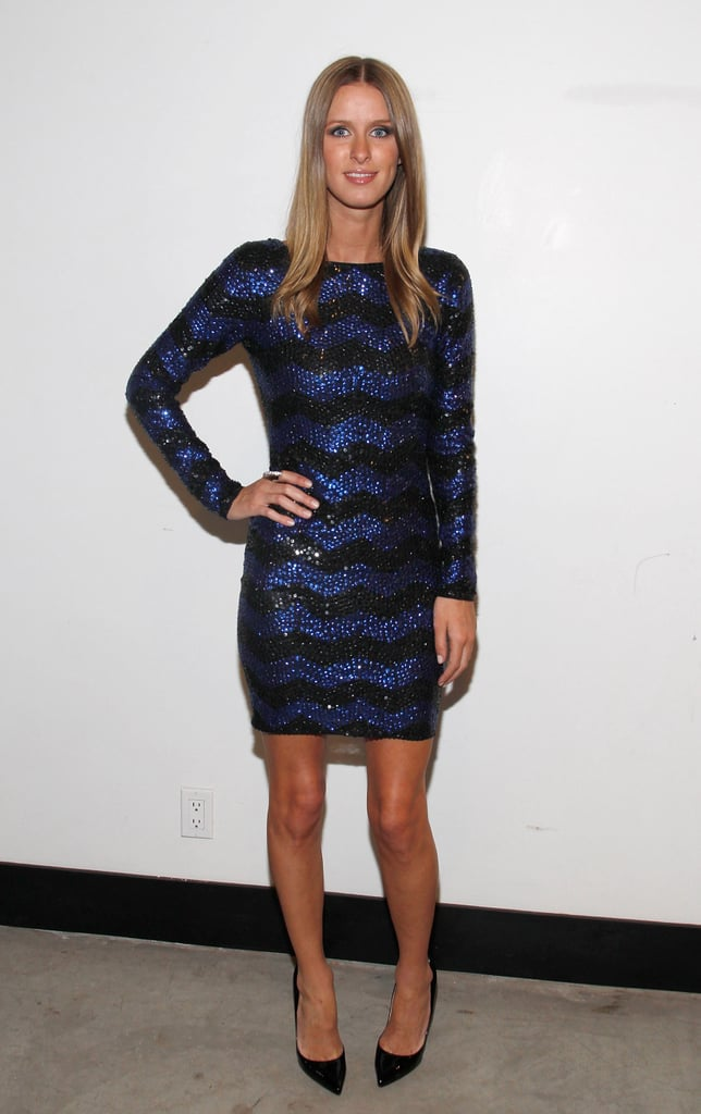 Nicky Hilton takes a cool approach to sequins in a striped and sparkly party dress.