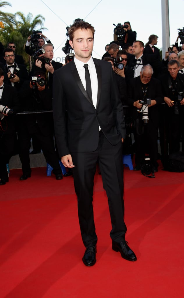 Robert Pattinson posed on the red carpet for girlfriend Kristen Stewart's On the Road premiere at the Cannes Film Festival.