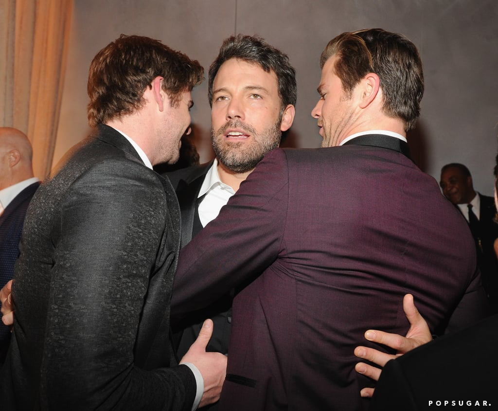 Ben Affleck was in the middle of a Hemsworth brother sandwich at the Vanity Fair Oscars afterparty.