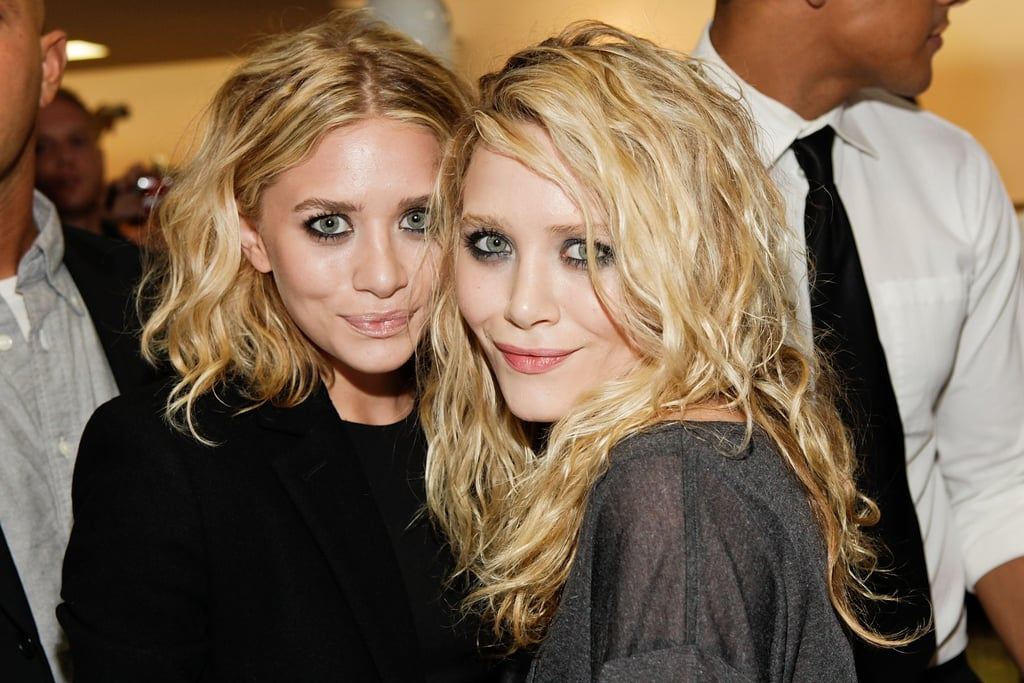 Ashley and Mary-Kate Olsen posed together during a Barneys New York event in 2009.