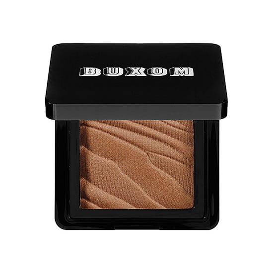 The quickest way to fake a tan is to stock a bronzer like Buxom Hot Escapes ($28) in your makeup kit. Swipe this product around the outer edges of the face, on the cheeks, and on the chin for a natural-looking contour that washes away.