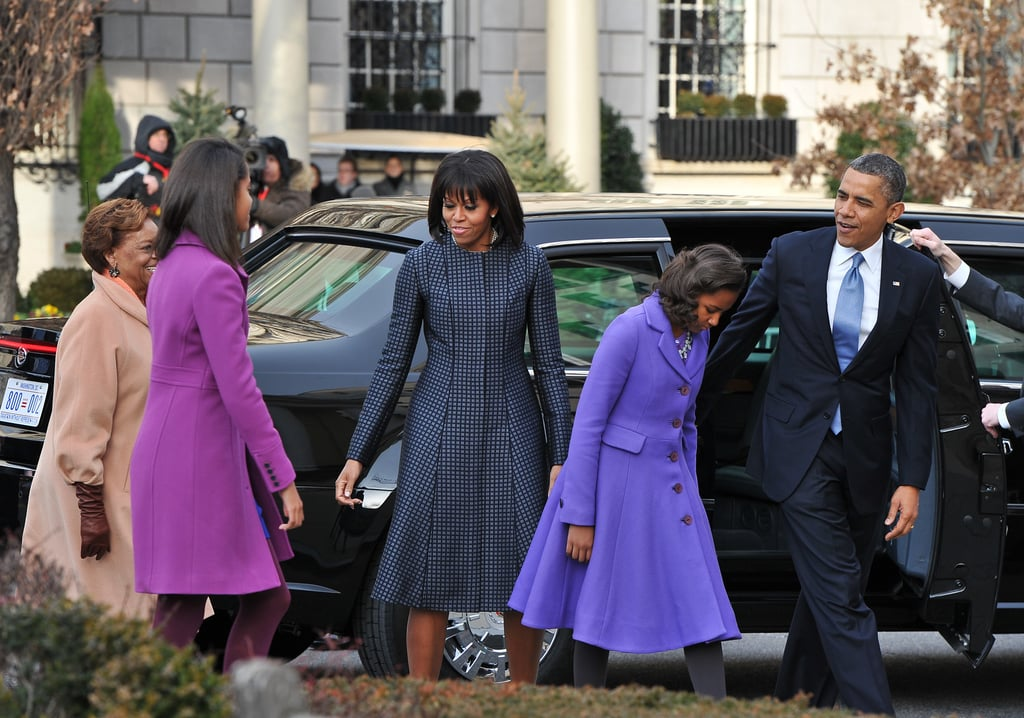 Michelle arrived at St. John's Church this morning with her family wearing a navy fit-and-flare Thom Browne coat paired with J.Crew pumps.